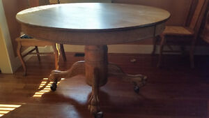 Antique oak clawfoot table and 4 matching chairs