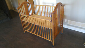 Crib that grows with baby to toddler bed