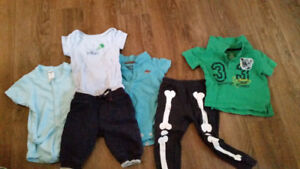 1 bag and 1 box baby boy clothes and accessories