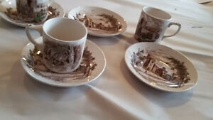 Three cups four saucers