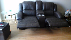 Reclining leather couch and love seat. Price reduced for quick s