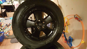 Ford Escape or Mazda Tribute wheels with decent rubber. 5x108.