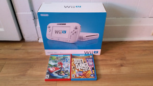 Wii u like new in box with 2 games