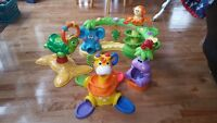 assorted toys, summer infant bath seat