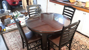 48 inch table and 4 chairs glass cover extends to 66 inches