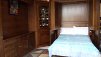 Hand crafted solid oak system of units with Murphy bed