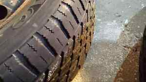 2 winter tires with decent grip left.. And two hubs 185/64r14 London Ontario image 4