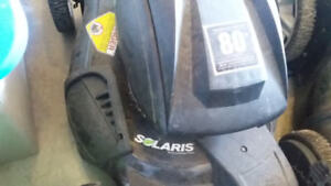 BATTERY OPERATED LAWNMORE second one free for parts