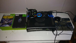 Used Xbox 360 + 9 Games + 2 rechargeable battery packs