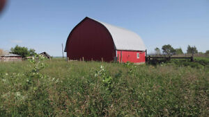 Rural acreage with house and outbuildings for sale