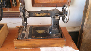 2 antique sewing machines