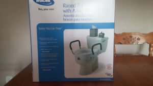 For Sale. Raised Toilet Seat with Arms