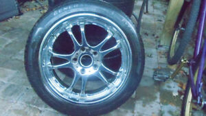 205/50/17 TIRES AND CHROME RIMS