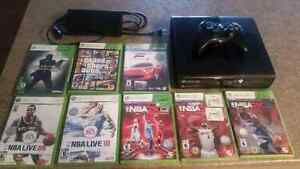 4GB XBOX 360 with Wireless Controller and 8 games.