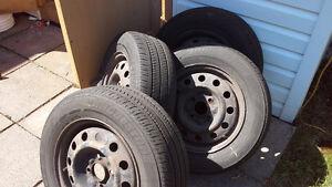 4 Bridgestone 195/65R15 on rims