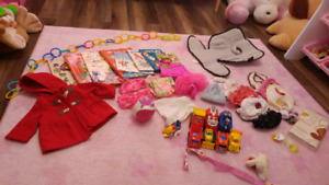 Baby girl items 0-3 months bathing suit jacket toys. Etc