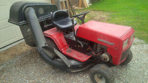 Riding lawnmower with grass catcher