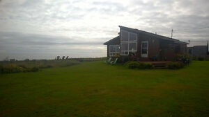 Spectacular waterfront cottage with extra waterfront lot.