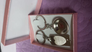 All couple keychains with pink box.
