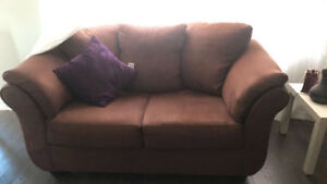 Leon's Beautiful sofa and love seat barely used