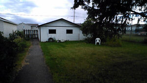 House for rent with large fenced backyard and dbl garage