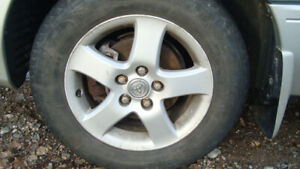 four toyota aluminum rims off camry. 5x114.3 pattern michelin