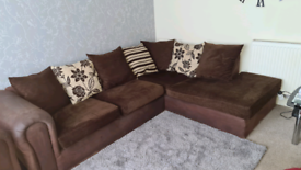 Brown corner sofa and cuddle chair