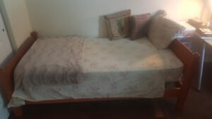 Twin bed with solid wood frame