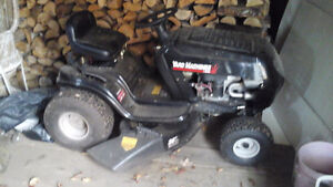Yard machine ride on lawnmower  and a weed eater feather lite