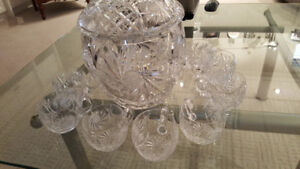 beautiful crystal punch bowl with 12 matching cups
