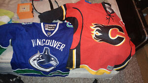 Calgary Flames and Vancouver Canucks home jerseys official