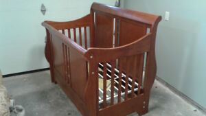 Sleigh bed style baby crib.