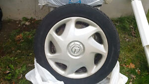 Dunlop  Winter Used 4 Tires with rims - good for one more winter West Island Greater Montréal image 3