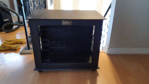 Dark brown wood kennel/crate for dogs. Sturdy metal cage & lock.