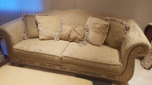 2 sofas with cushions