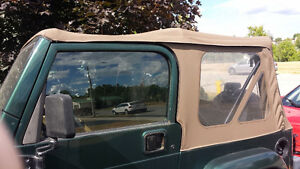 Tan Jeep TJ soft top with door bar and frame