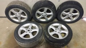 Toyo Blacklion tires P215/55R16 on Nissan rims.  Set of 5