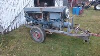 Antique Lincoln DC portable welder on wheels with hitch.