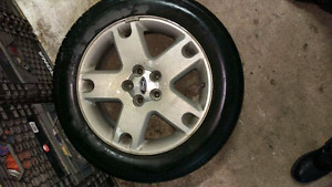 225-60-18 summer tires with Ford mags/pneus d ete avec mags
