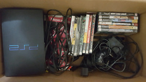 PS2 with games and 3 ddr matts