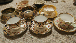 8 antique bone china teacups and saucers.