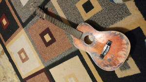 A small childs acoustic guitar