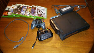 Xbox 360 120GB with 2 controllers and 8 games