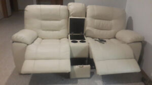Like brand new- white leather power operated sofa & Chair
