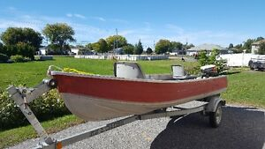 14ft Aluminum boat, 9.9 hp older Johnson and 2011 Easy Loader Tr