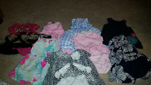 8 dresses sz 9 month. Worn once. Almost all are carter