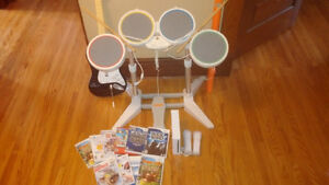 Wii console with drum set, guitar and games