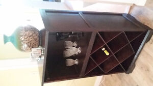 Display case with wine rack.