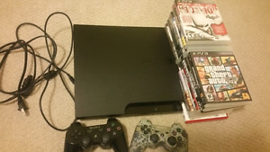 PS3 with 2 Controllers and 19 games