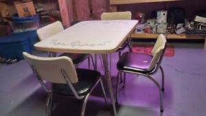 Vintage Chrome table and four chairs.